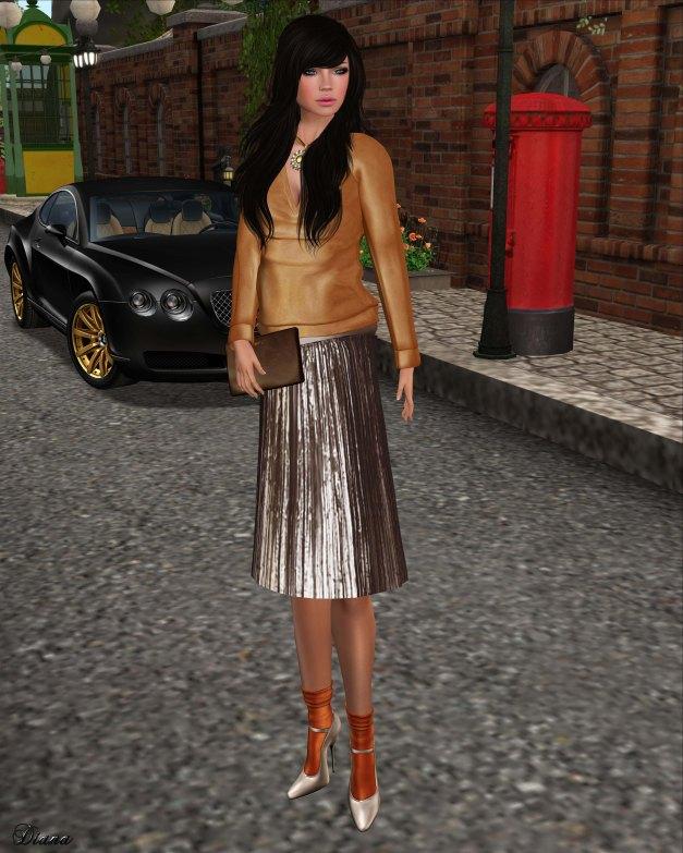 Baiastice - Vena oversize sweater orange and Metallic Plisse Skirt carafe